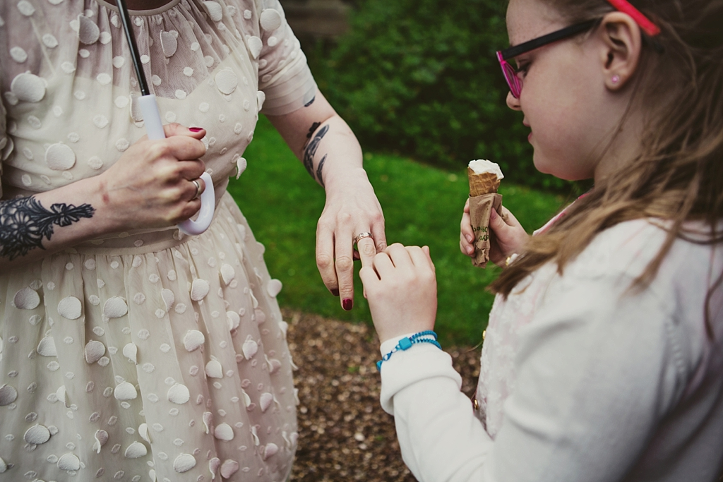 Little girl admires wedding ring Derby wedding photographer Lisa Jane Photography