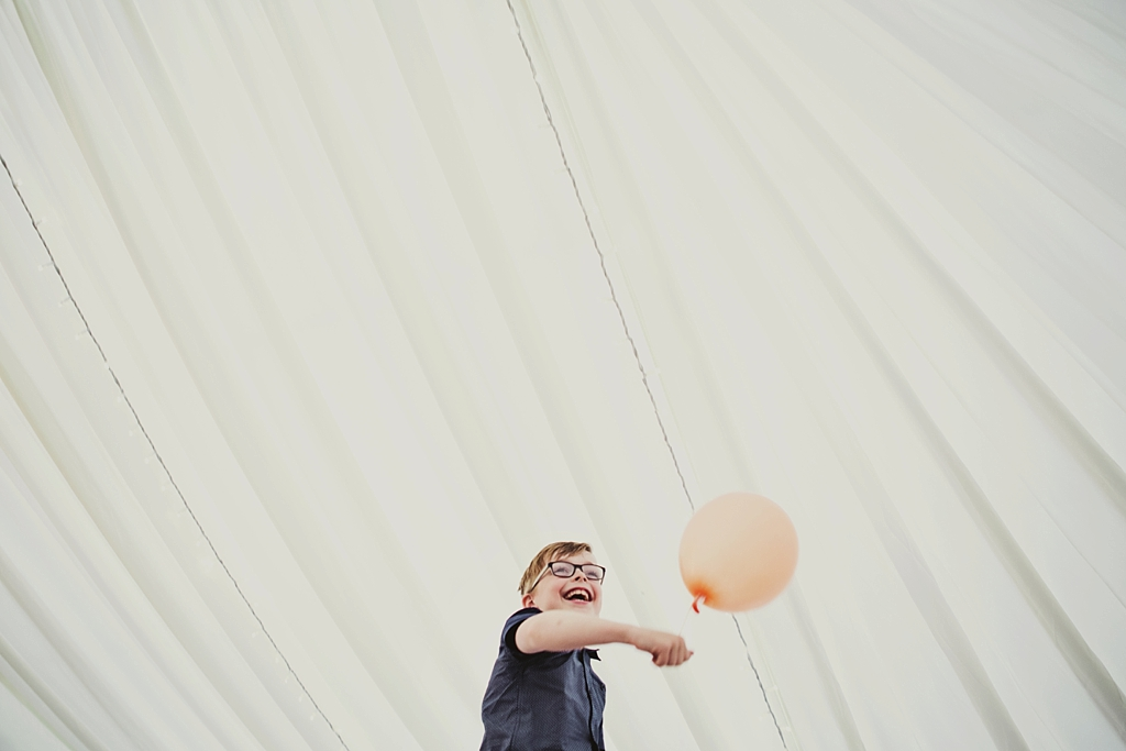 Cute boy with balloon at Derby wedding