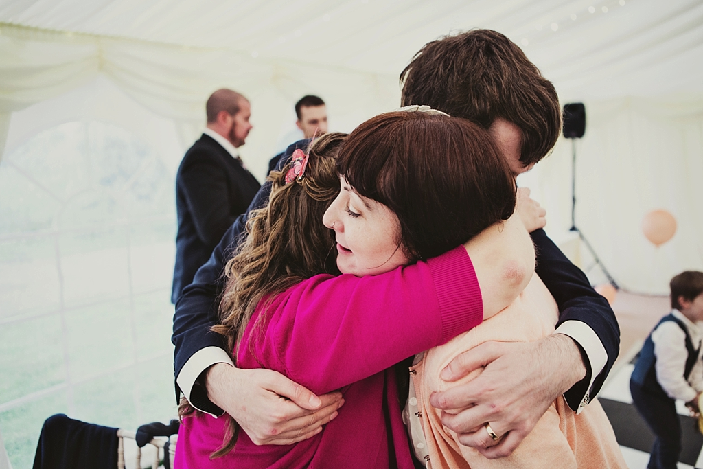 Hugging at Derby movie and book themed wedding