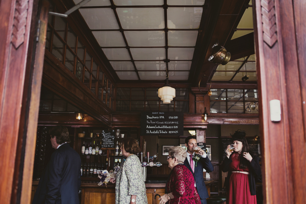 weddings guests in a pub by Lisa Jane Photography