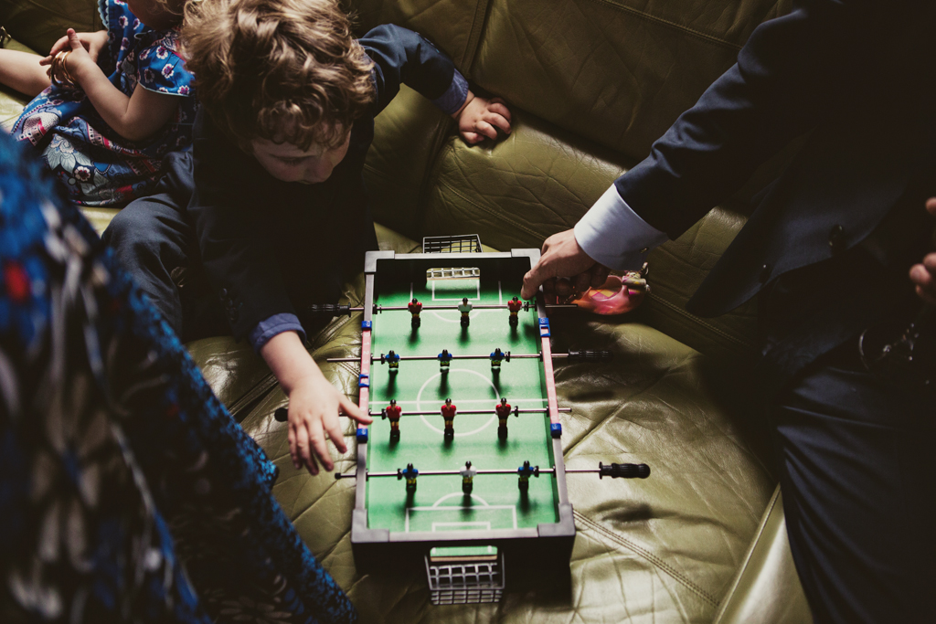 guests playing table football at a wedding in Hackney