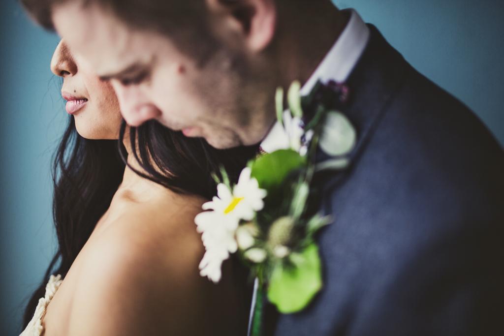 groom hugging bride at The Roost in East London