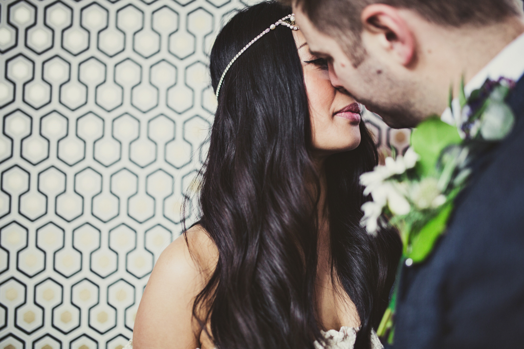 groom kissing his bride at The Roost in Hackney