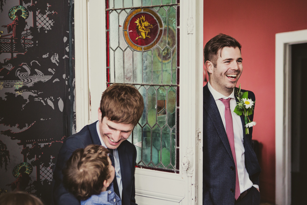 groom smiling at an east london wedding by Lisa Jane Photography