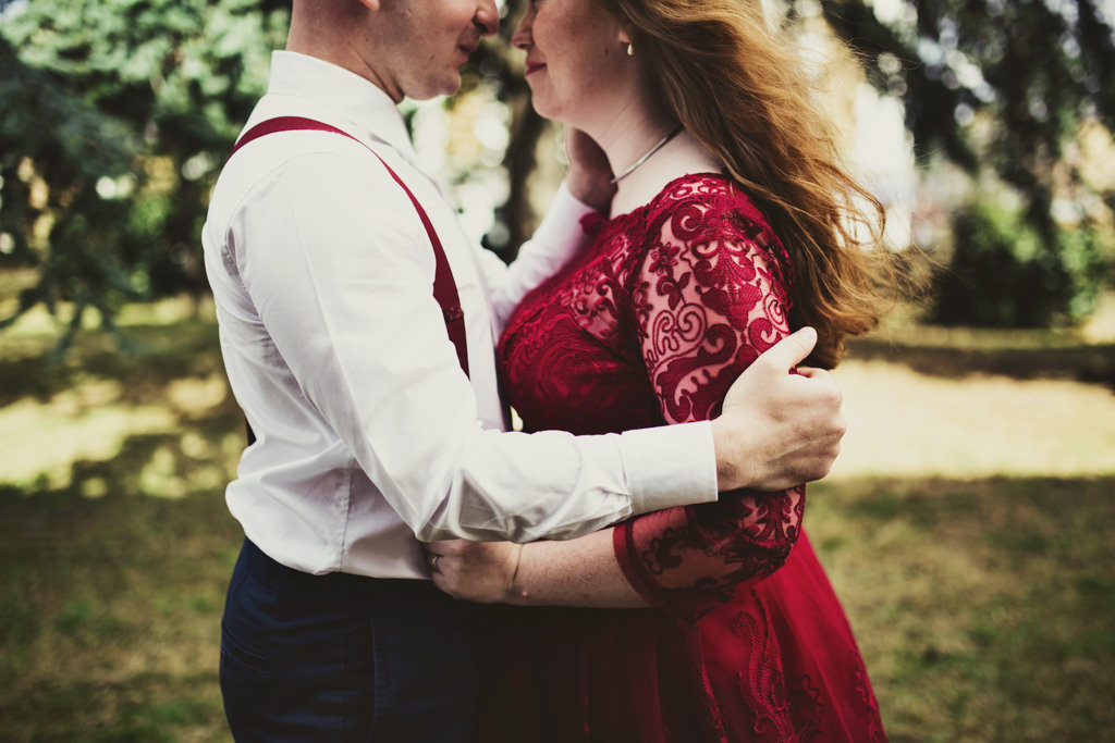 Vintage red bride with groom wearing red braces London elopement wedding
