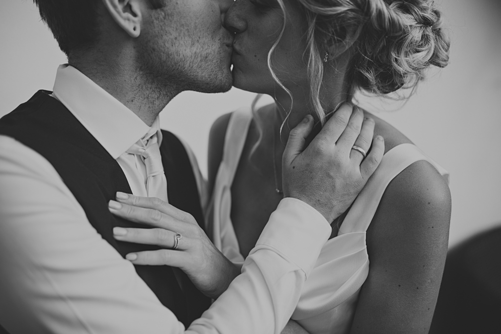 Creative destination wedding photography - Bride and groom kissing