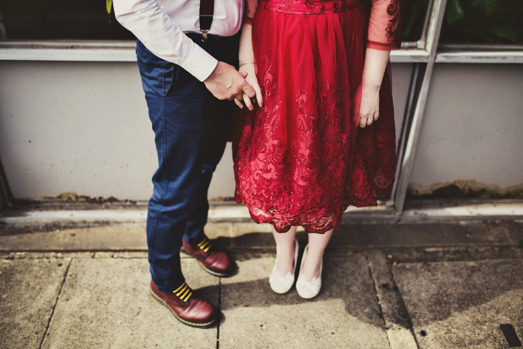 Quirky wedding portrait bride with groom shoes Elopement wedding photography London