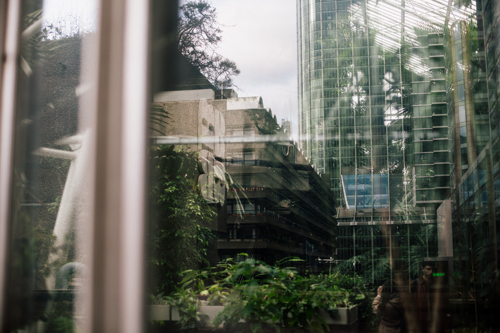 reflection of the city in the barbican conservatory