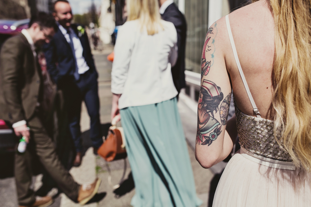 Quirky wedding photography with tattooed wedding guest Brighton