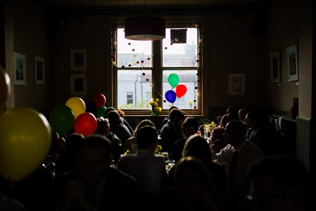 guests sitting at tables at a Brighton pub wedding