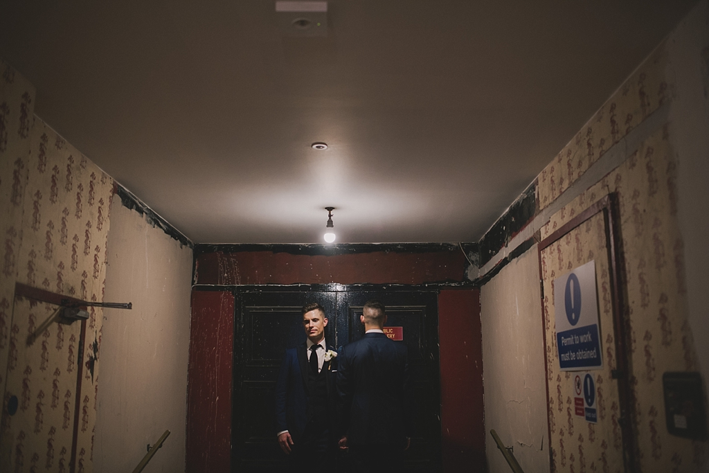 Grooms portraits inside Battersea Arts Centre by Lisa Jane Photography
