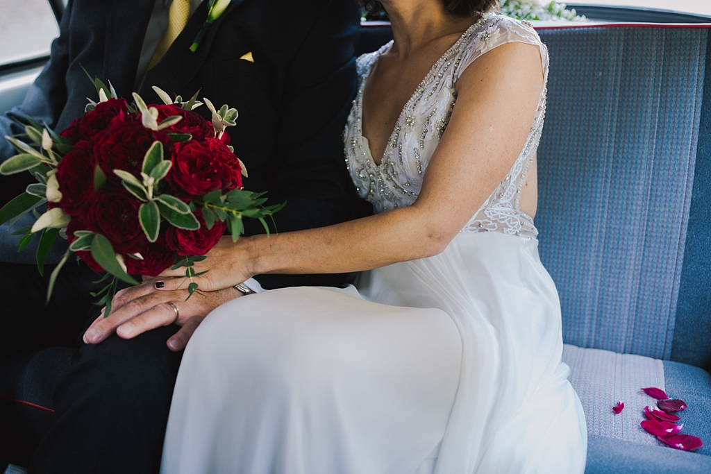 bride holding dads hand in taxi on the way to her wedding ceremony | Wiltons Music Hall Wedding Photographer | Lisa Jane Photography