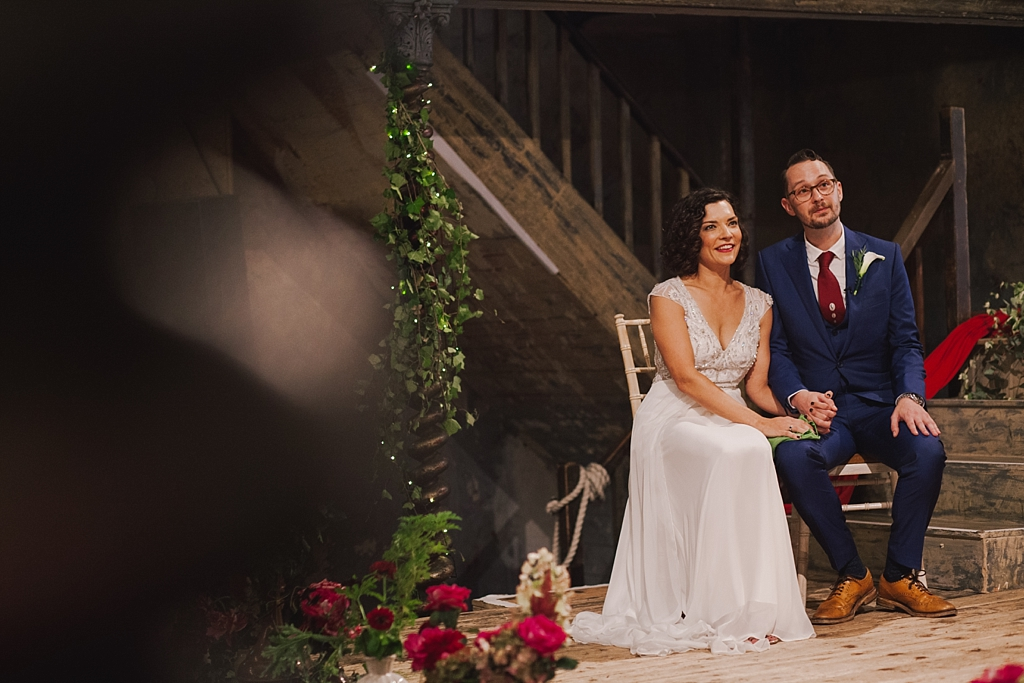 bride and groom smiling during wedding ceremony at Wiltons Music Hall