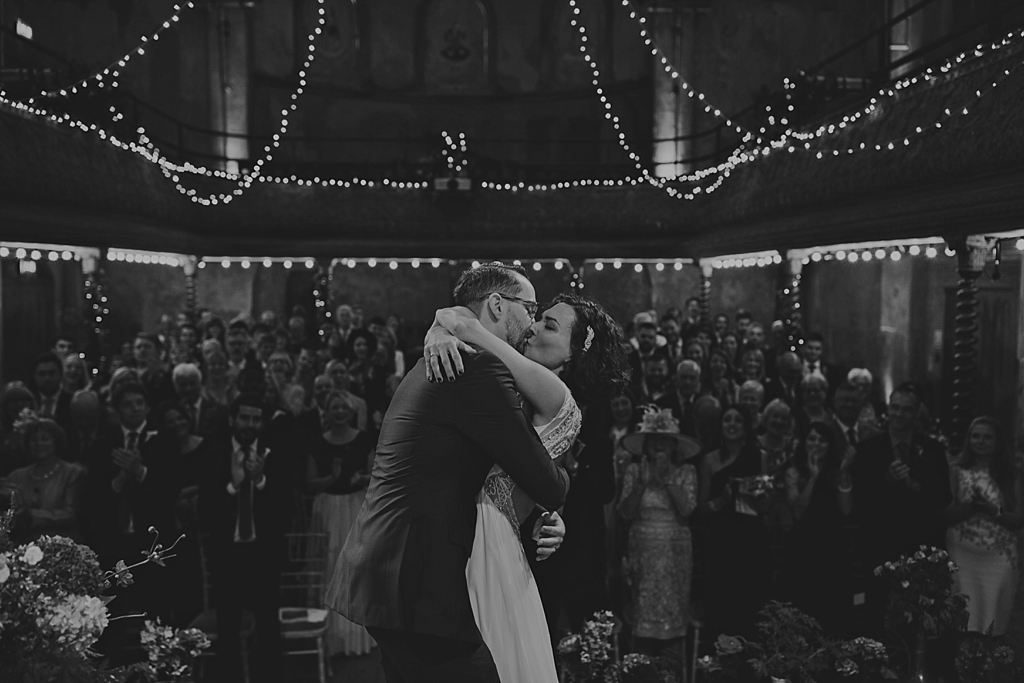 first kiss at a WIltons Music Hall wedding ceremony