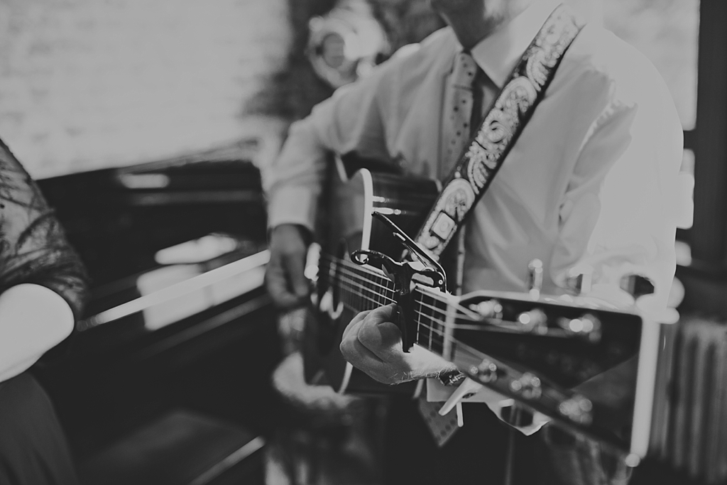 dad playing guitar at a wiltons music hall wedding | Wiltons Music Hall Wedding Photographer | Lisa Jane Photography