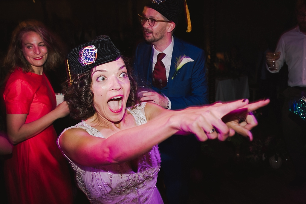 Bride on the dance floor in a custom made fez | Wiltons Music Hall Wedding Photographer | Lisa Jane Photography