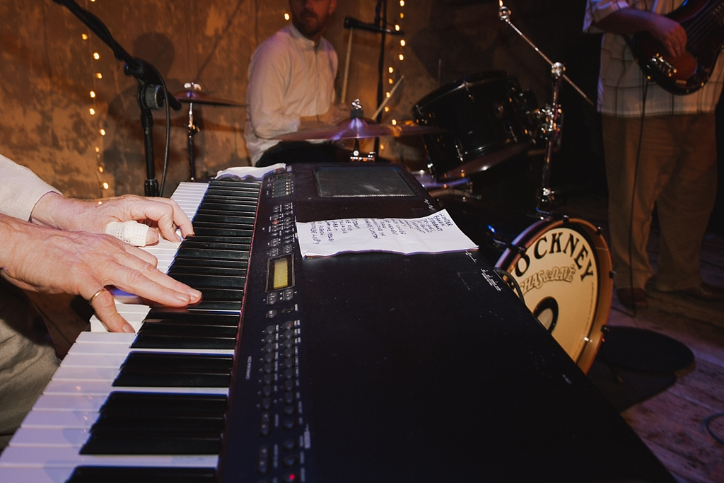 Chas from Chas & Dave. playing piano at a Wiltons Music Hall Wedding | Lisa Jane Photography