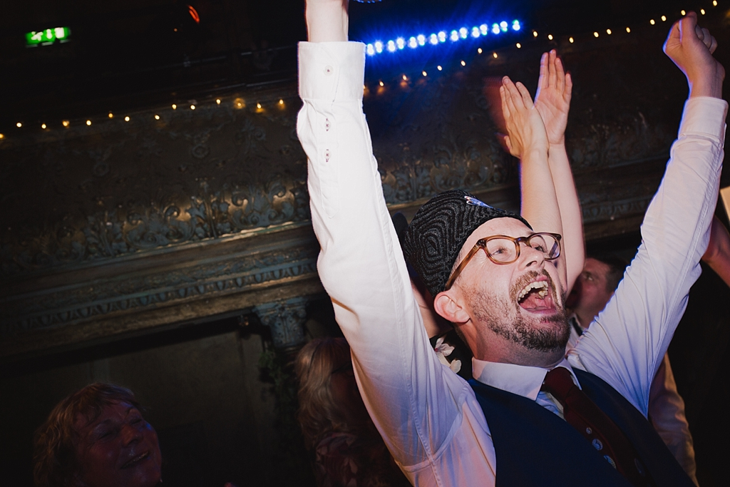 Groom in his custom made fez at a wiltons Music Hall Wedding