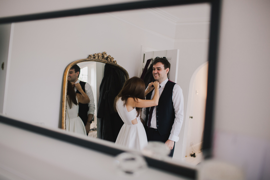 Couple getting ready together at a London Elopement | Lisa Jane Photography | London Elopement Wedding Photography