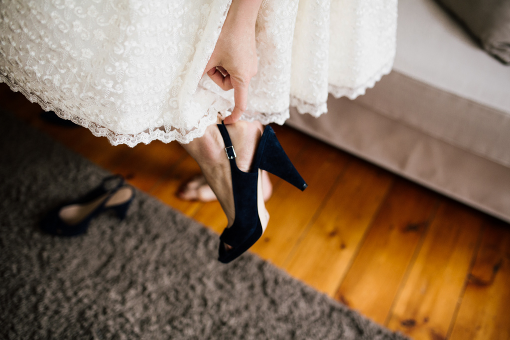 Bride putting on shoes at a Brighton Town Hall Wedding | Lisa Jane Photography | Alternative UK Wedding Photography