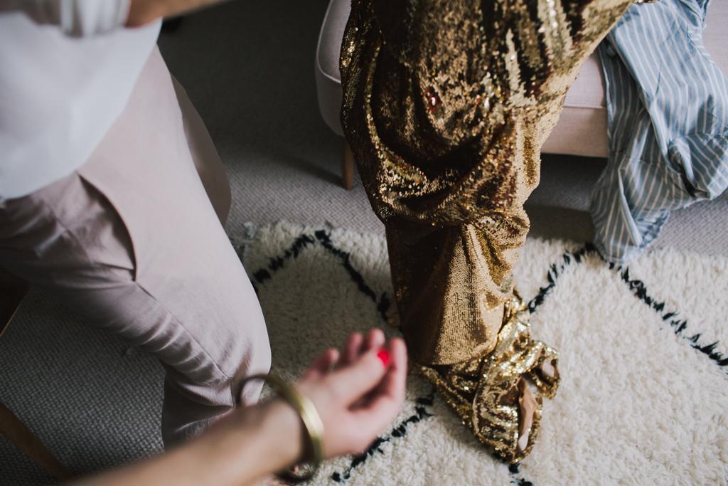 Bride putting on her bespoke gold wedding dress | Lisa Jane Photography | Creative London Wedding Photography