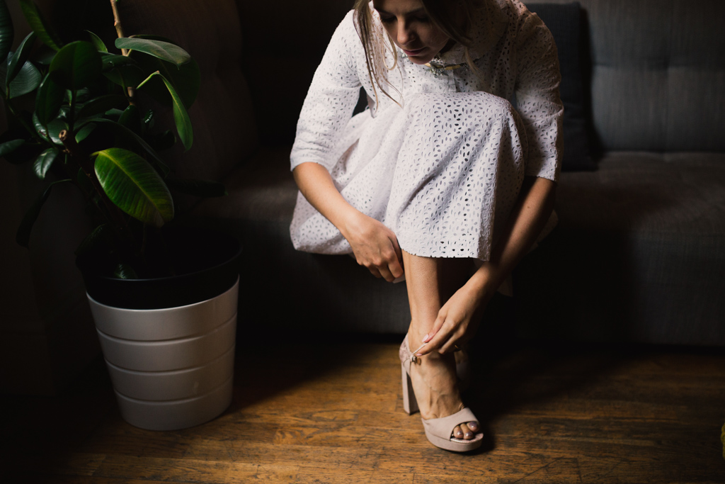 Bride putting on her shoes at a London Elopement | Lisa Jane Photography | Creative London Wedding Photography