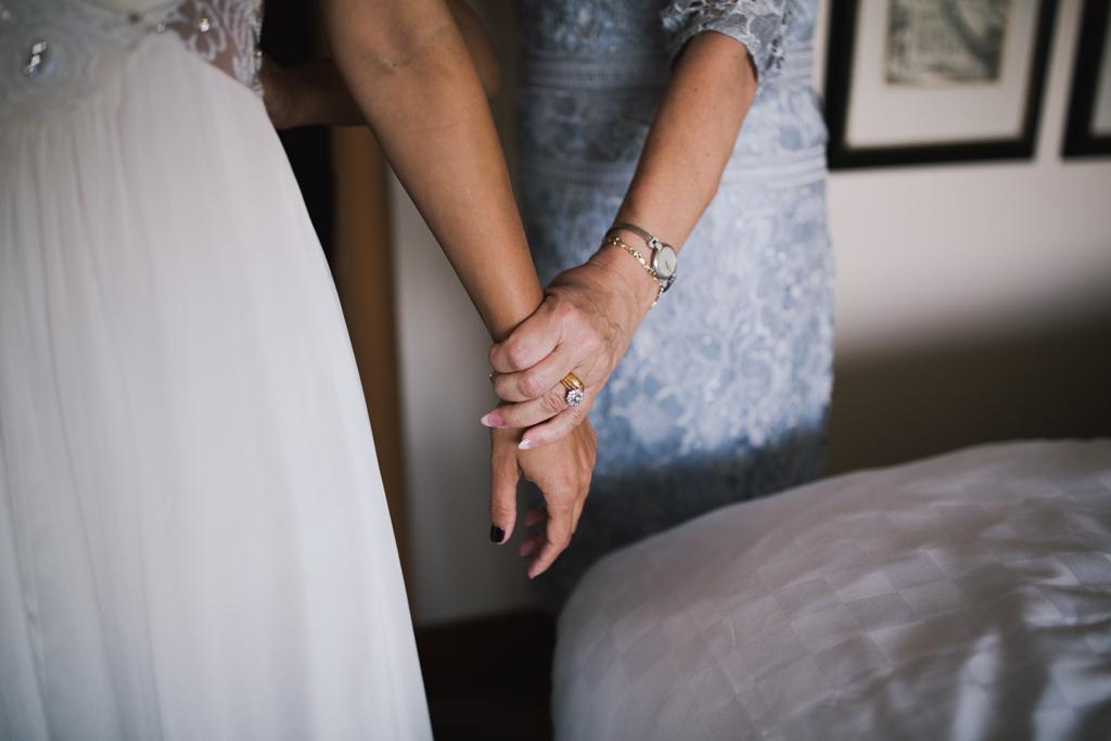 Mum holding brides hand at Wiltons Music Hall Wedding | Lisa Jane Photography | Creative London Wedding Photography