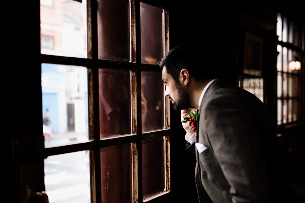 Nervous groom at pub moments before a Stoke Newington Town Hall Wedding | Lisa Jane Photography | Creative London Wedding Photography