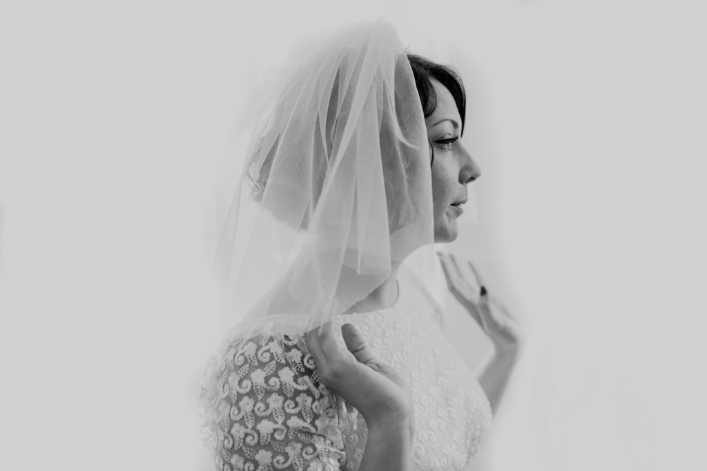 Bride checking herself in the mirror | Lisa Jane Photography | Creative Modern Wedding Photography