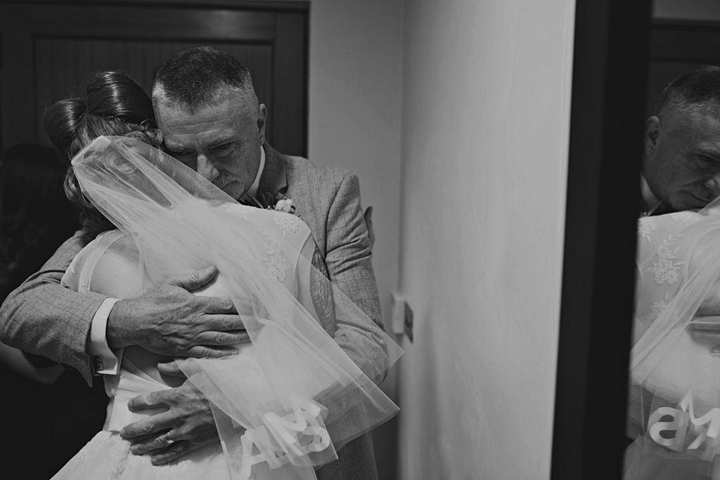Bride hugging her dad at Northbrook Park Wedding | Lisa Jane Photography | Creative London Wedding Photography