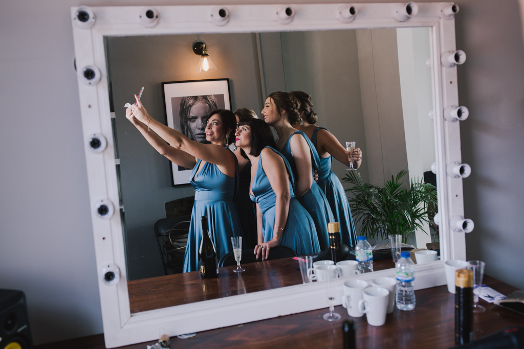 Bridesmaids taking a selfie at Loft Studio Wedding | Lisa Jane Photography | Creative London Wedding Photography