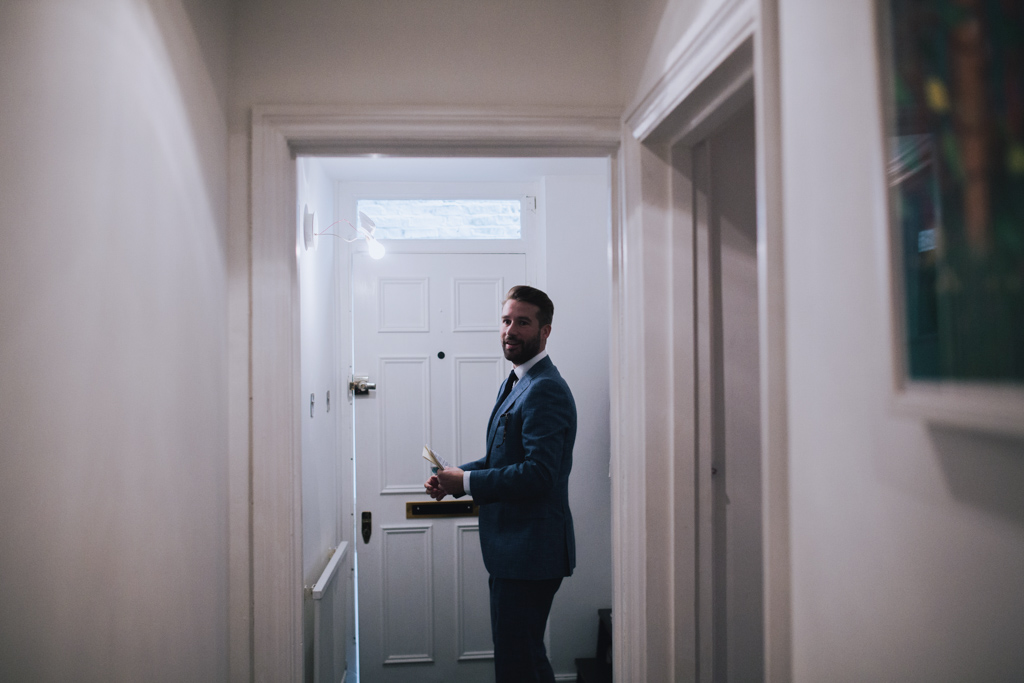Groom leaving flat at London Elopement | Lisa Jane Photography | Creative London Elopement Wedding Photography