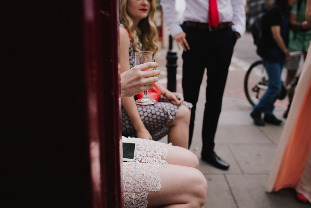 Bride having a drink before wedding ceremony | Lisa Jane Photography | Creative London Pub Wedding Photography