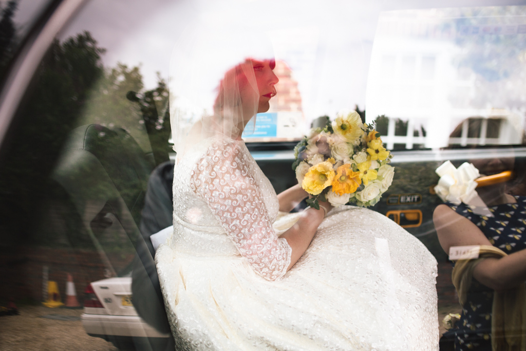 Bride in taxi at Brighton Town Hall Wedding | Lisa Jane Photography | Modern Brighton Wedding Photography