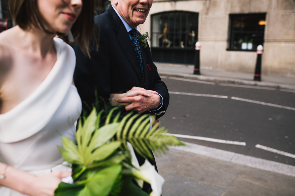 Bride walking to her Barbican Wedding with her dad | Lisa Jane Photography | Modern London Wedding Photography
