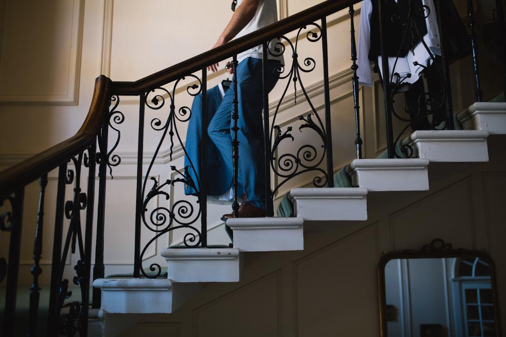 Groom walking down stairs | Lisa Jane Photography | Modern London Wedding Photography