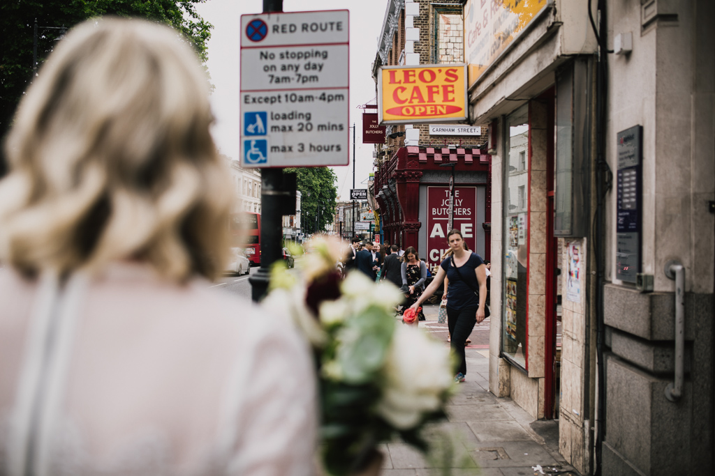 Bride outside The Jolly Butcher on Stoke Newington High Street | Lisa Jane Photography | Modern London Wedding Photography