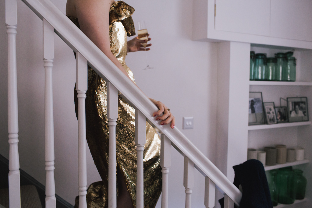 Bride in bespoke gold dress walking down stairs to a london first look | Lisa Jane Photography | Modern London Wedding Photography