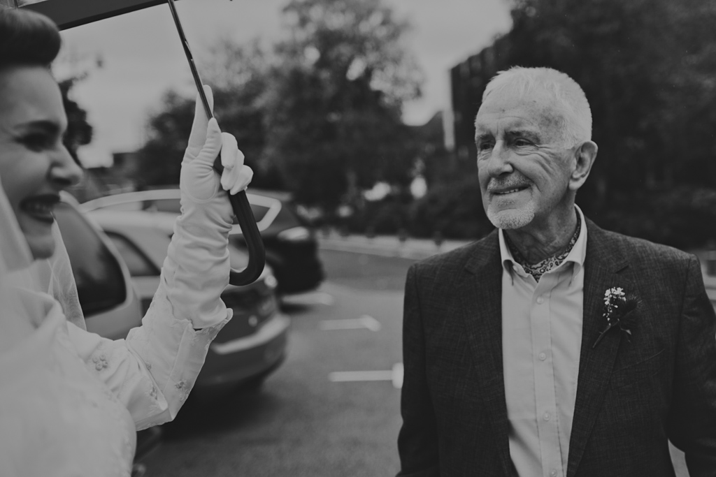brides dad seeing bride outside her wedding ceremony | Lisa Jane Photography | Modern Documentary London Wedding Photography