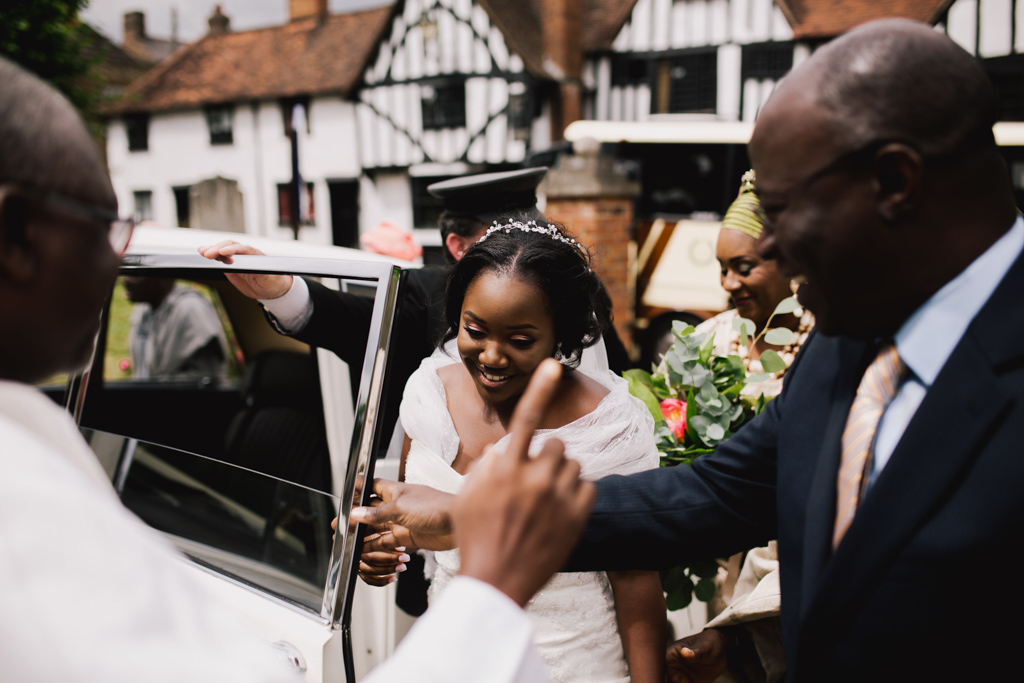 Bride getting out of car at London church wedding | Lisa Jane Photography | Modern Documentary Wedding Photography