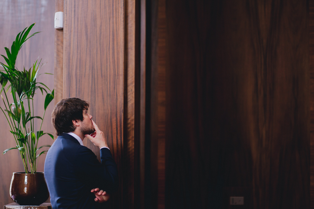 Nervous groom waiting for bride at Stoke Newington Town Hall | Lisa Jane Photography | Modern London Wedding Photography