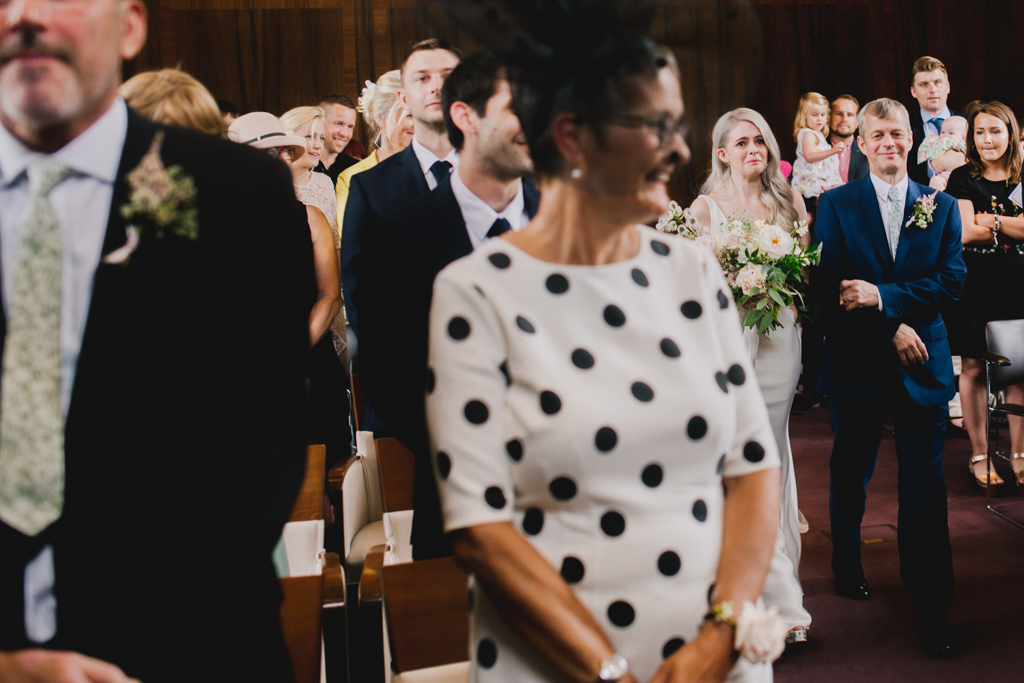 bride crying as she walks down the aisle at Stoke Newington Town Hall Wedding | Lisa Jane Photography | Modern London Wedding Photography