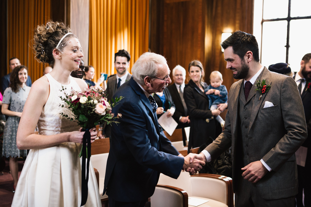 dad giving daughter away at a Stoke Newington Town Hall wedding | Lisa Jane Photography | Modern London Wedding Photography