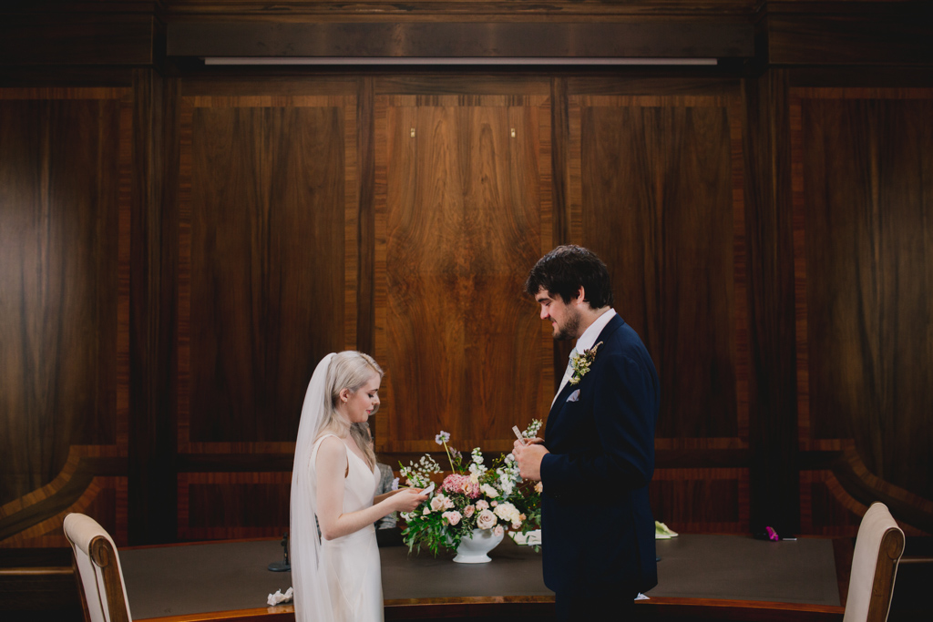 Bride and groom exchanging vows during a Stoke Newington Town Hall Wedding | Lisa Jane Photography | Modern London Wedding Photography