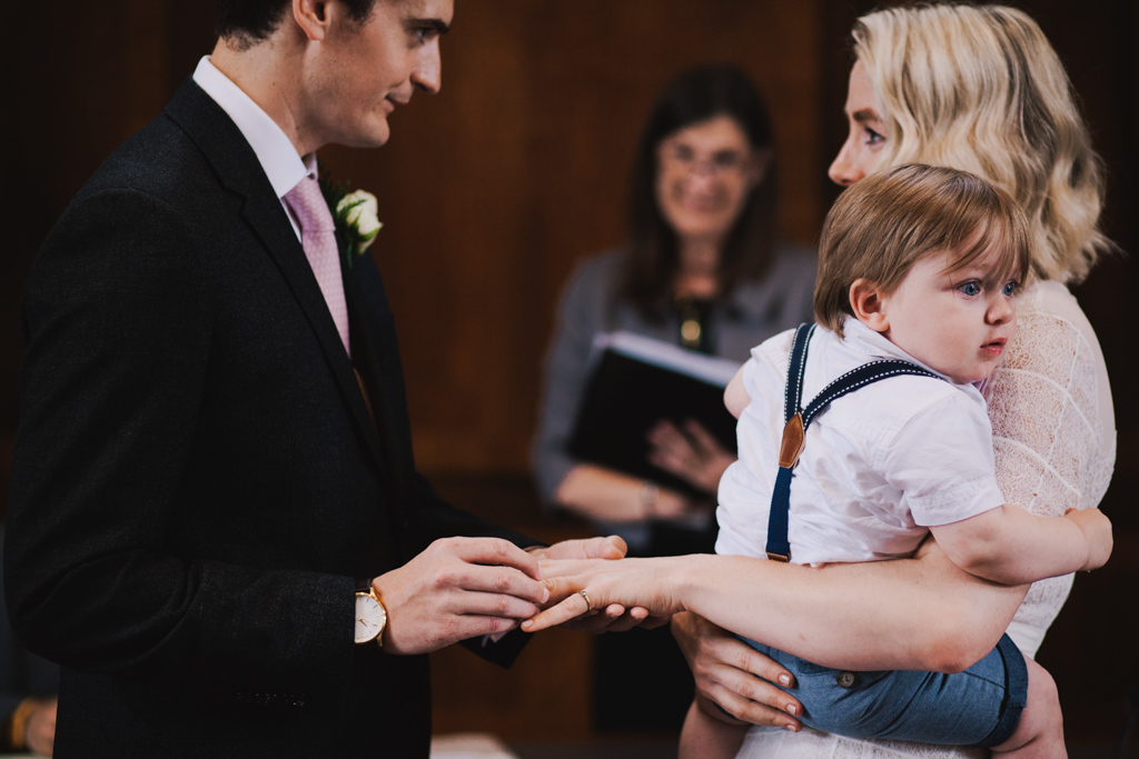 Bride and Groom exchanigng wedding vows at Stoke Newington Town Hall | Lisa Jane Photography | Modern London Wedding Photography