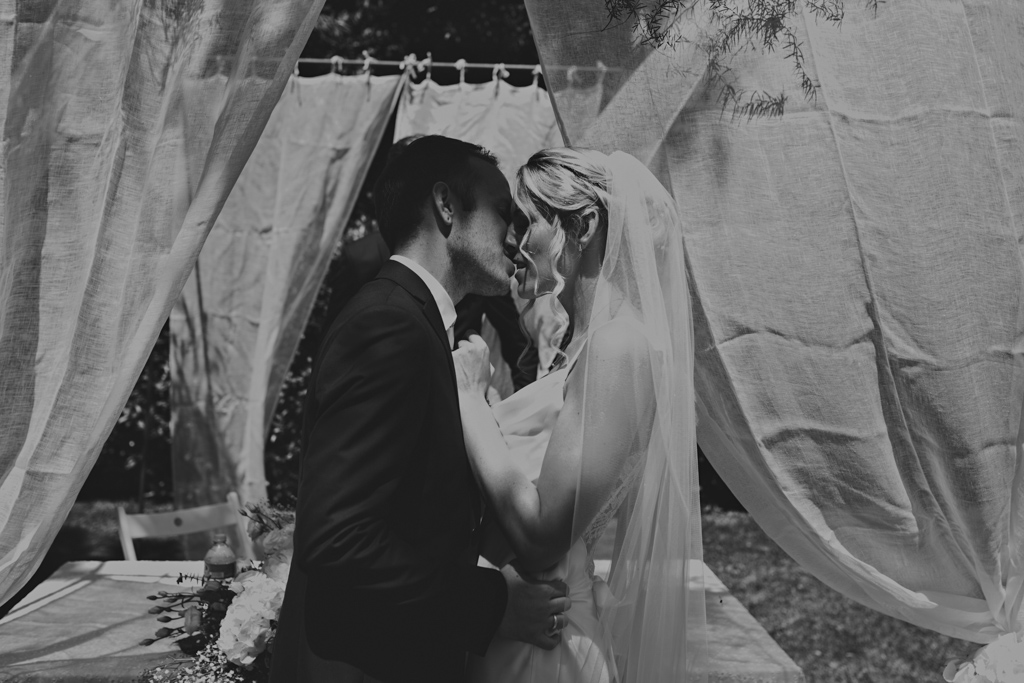 First kiss at an Italian outdoor wedding | Lisa Jane Photography | Modern Destination Wedding Photography
