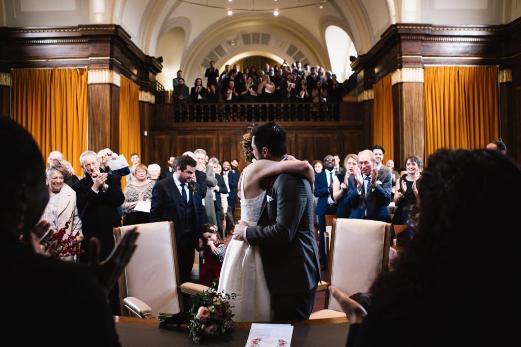 Bride and groom huging at Stoke Newington Town Hall wedding | Lisa Jane Photography | Modern London Wedding Photography