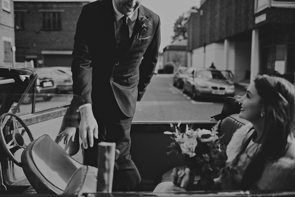 Groom getting into car after a couples London elopement | Lisa Jane Photography | Modern Elopement Wedding Photography