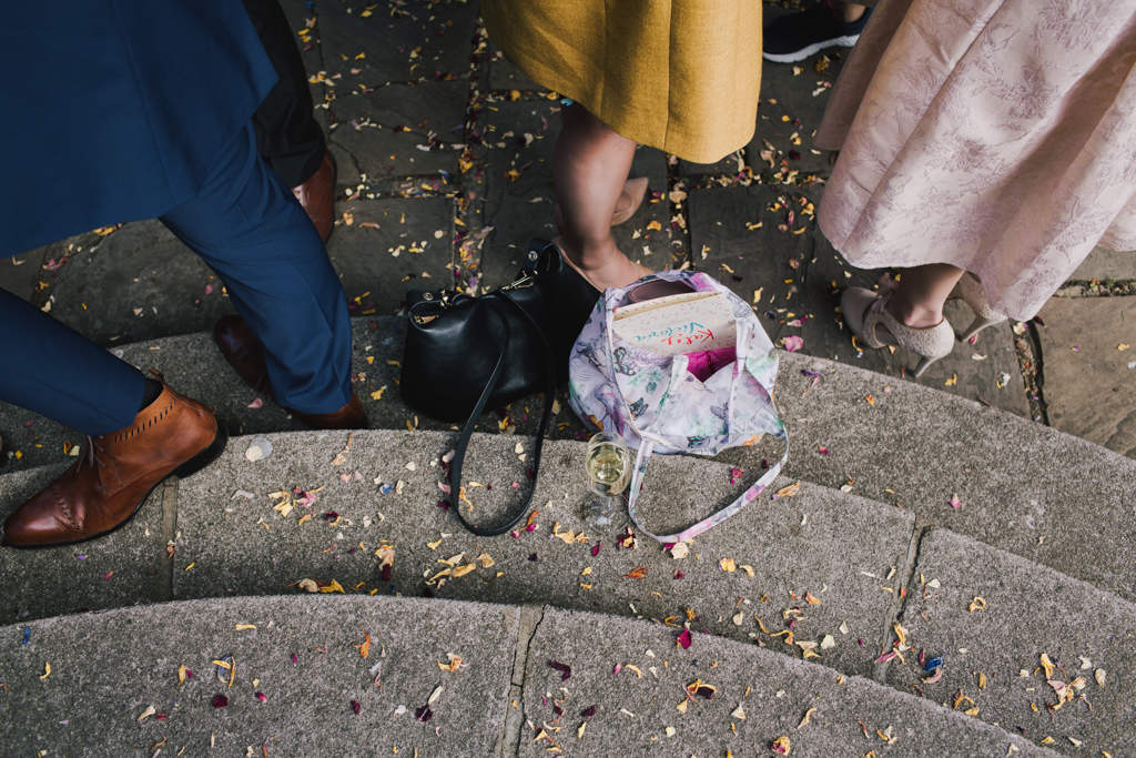 Guests waiting outside Cecil Sharp House | Lisa Jane Photography | Modern London Wedding Photography