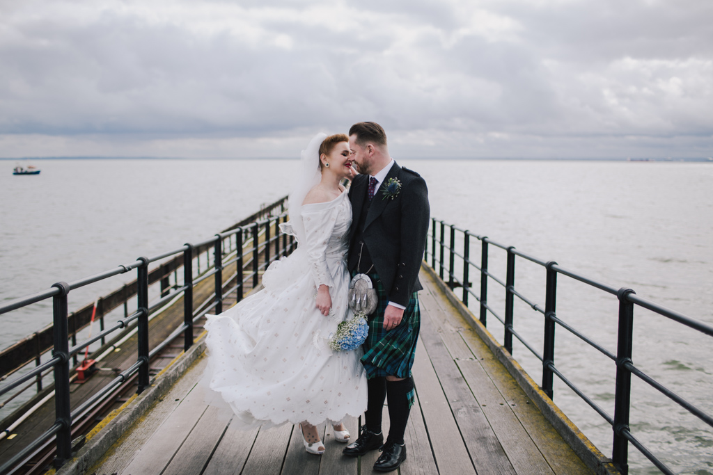 Couple hugging on Southend pier | Lisa Jane Photography | Modern London Wedding Photography